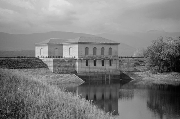 A black and white photo of the main water intake houses at the Ashokan reservoir in the Catskills.