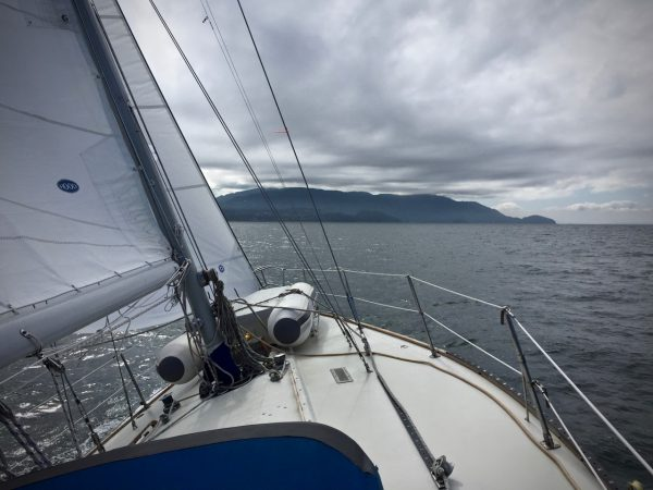 Day 1 starboard tack with moody clouds.