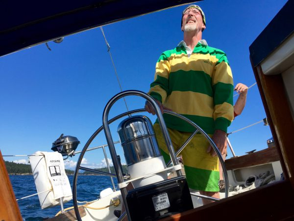 Sean, our captain in full regalia, at the helm.